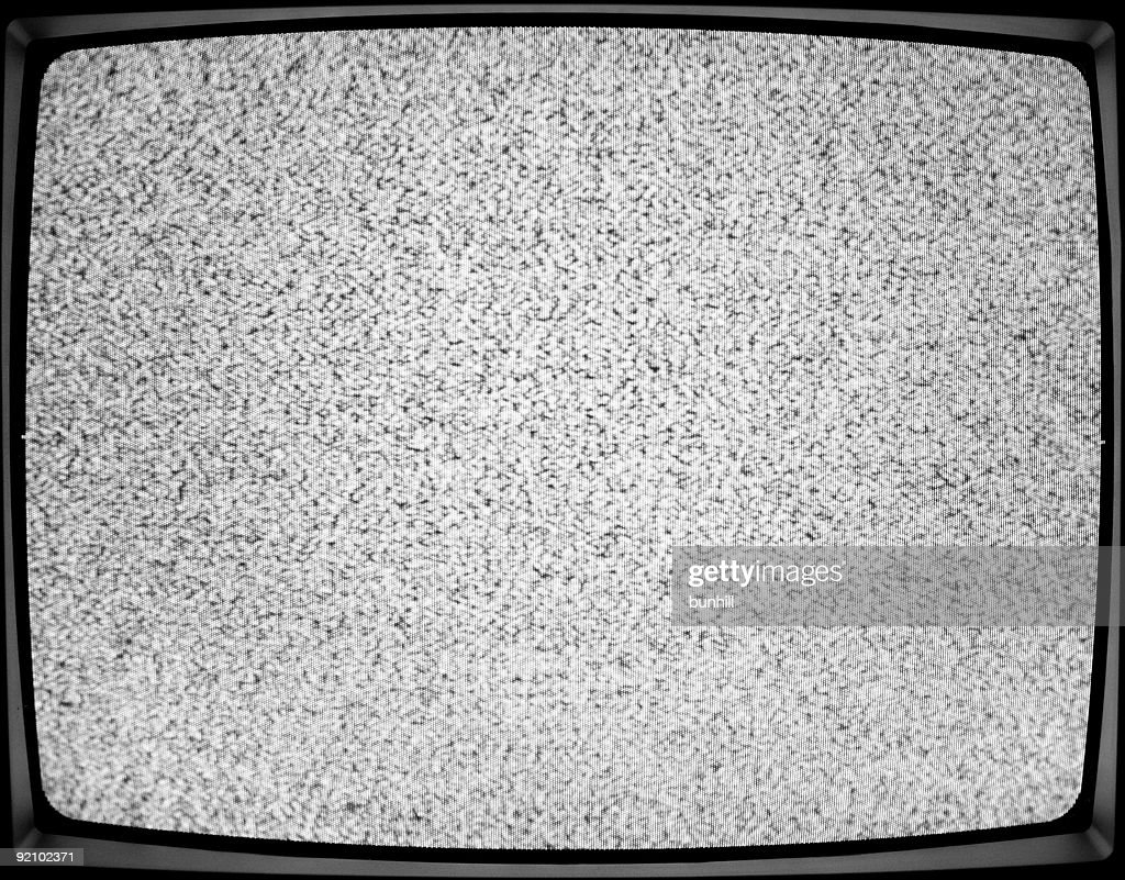 A close-up of a white noise on a TV screen : Stock Photo