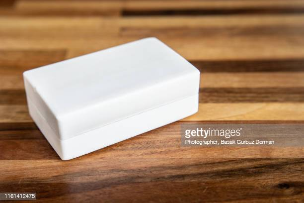 a close-up of a white organic bar of soap / shampoo - basak gurbuz derman stock photos and pictures