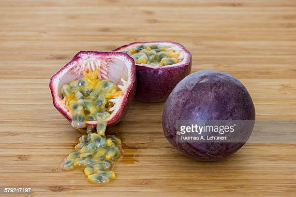 Closeup of a whole and split passion fruits