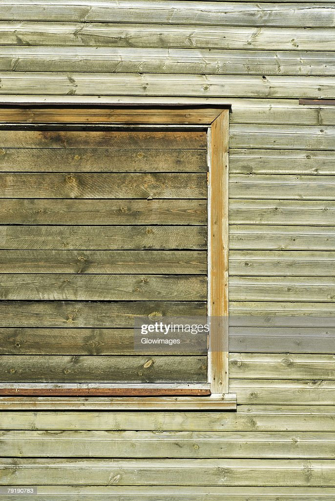 Close-up of a window on a wooden wall : Stock Photo
