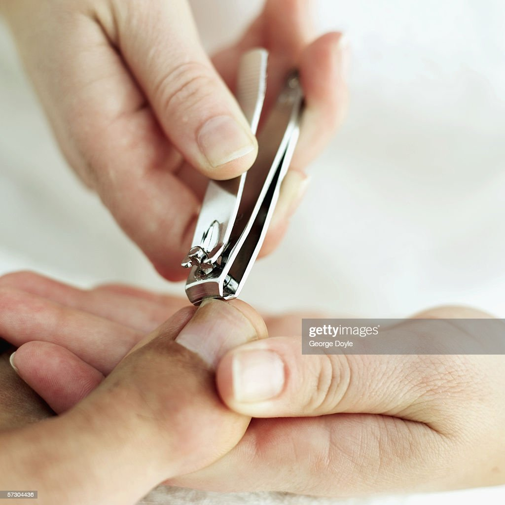 Closeup Of A Woman Cutting A Mans Toe Nails With A Nail Cutter Stock ...