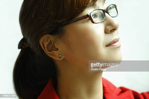 Close-up of a woman day dreaming