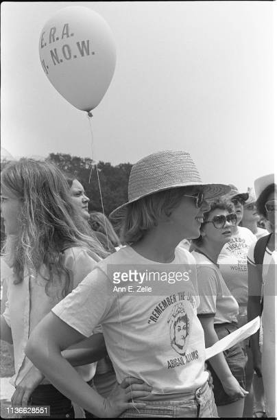 Closeup of a woman during the Equal Rights Amendment March Washington DC July 9 1978 Her tshirt quotes Abigail Adams' 'Remember the Ladies' a...