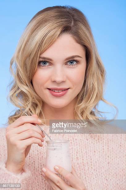 Close-up of a woman eating yogurt