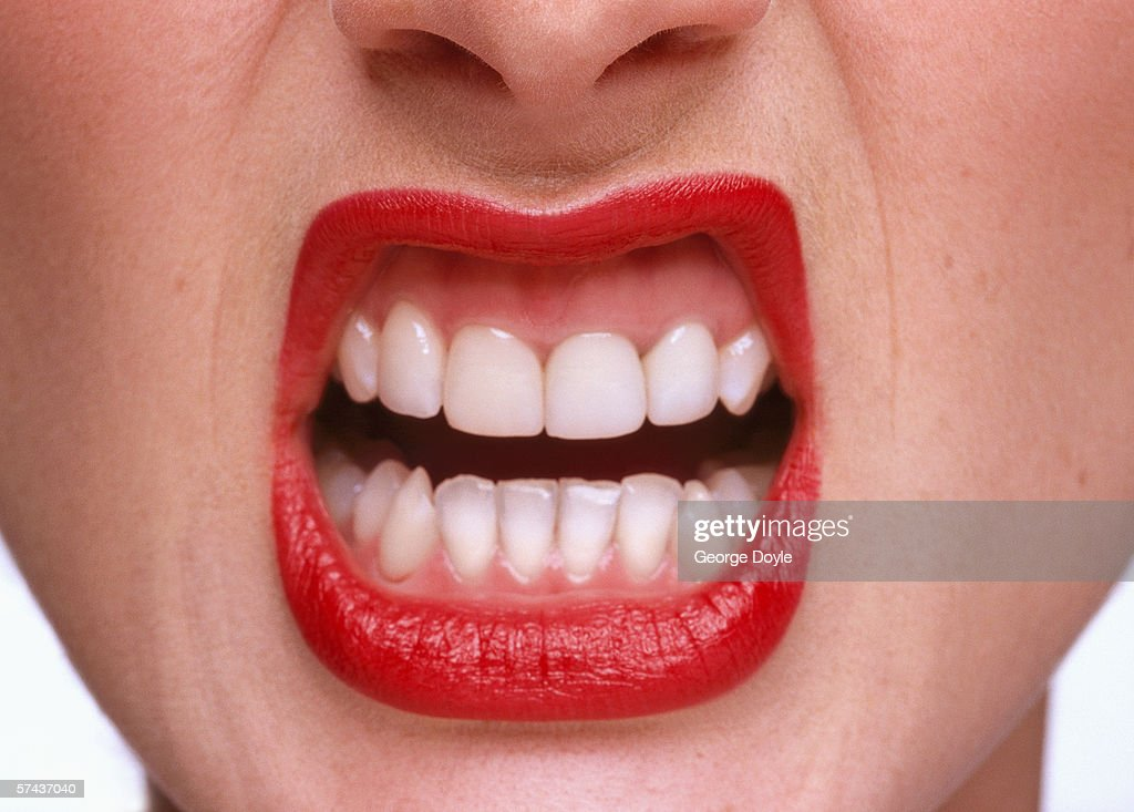 close-up of a woman exposing her teeth : Stock Photo