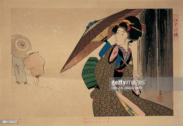 Closeup of a woman holding a parasol