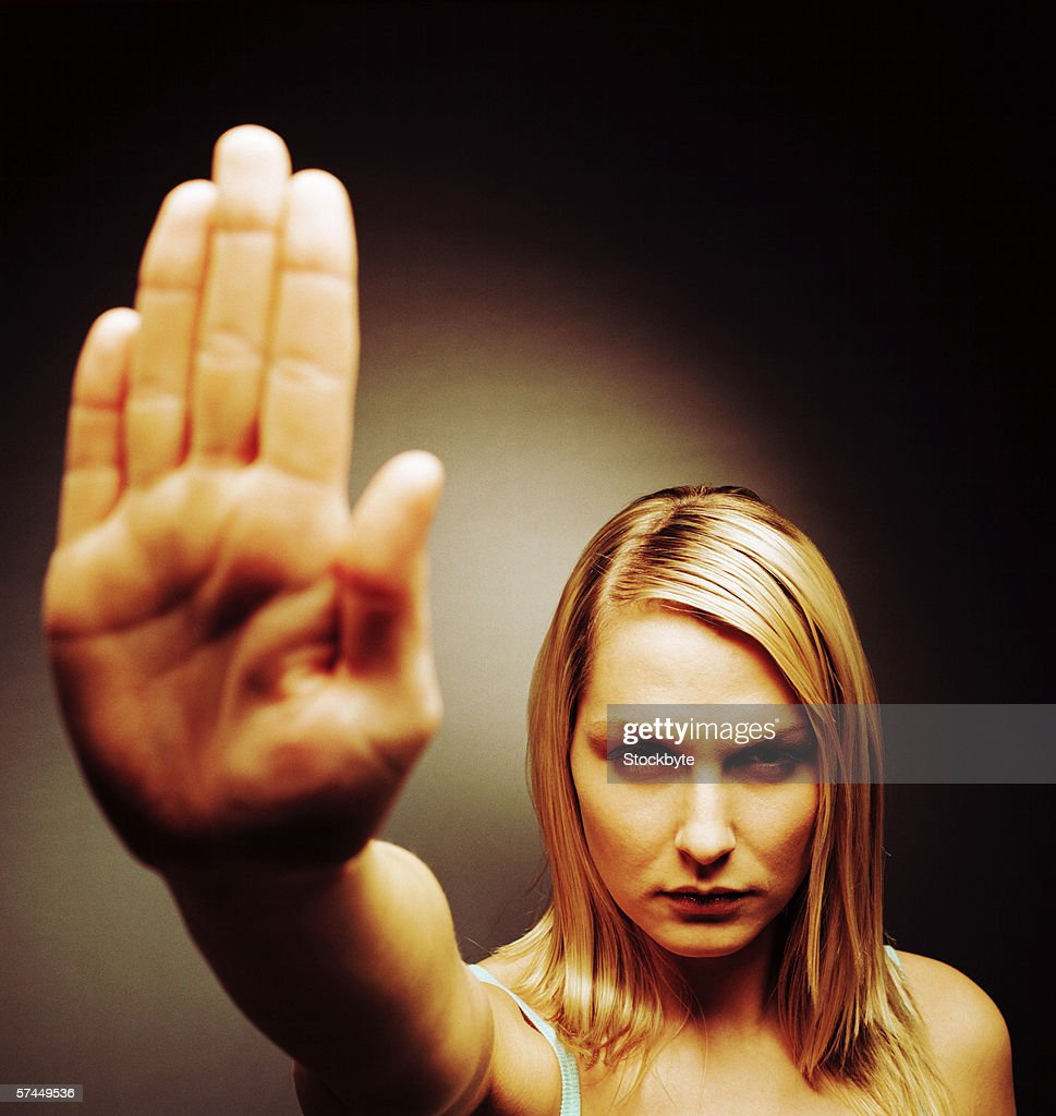 close-up of a woman holding her palm out : Stock Photo