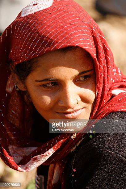 Close-up of a woman looking away and smiling, Jaipur, Rajasthan, India