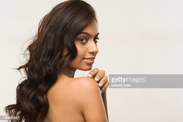 Naked Young Woman Looking Over Shoulder Rear View High-Res