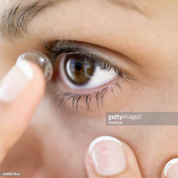 close-up of a woman putting in contact lenses