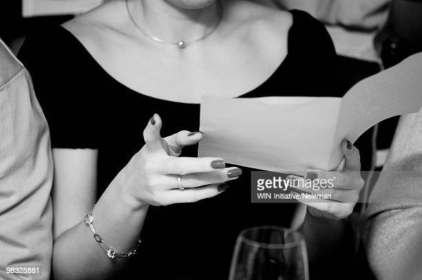 Close-up of a woman reading a menu card in a restaurant