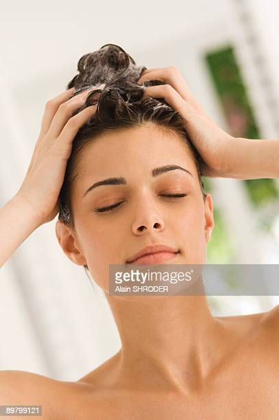 Close-up of a woman shampooing her hair
