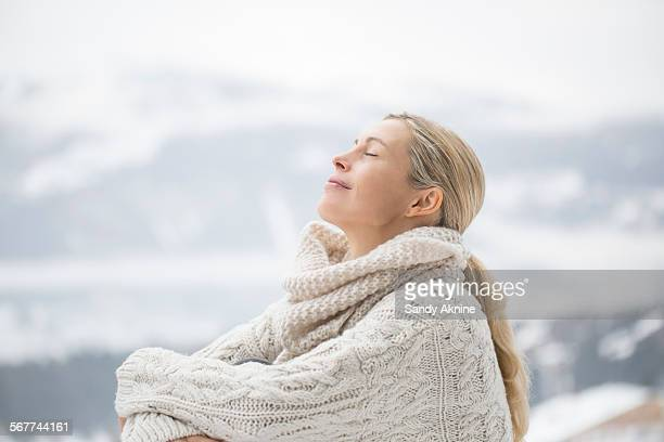 close-up of a woman sitting with her eyes closed, crans-montana, swiss alps, switzerland - einzelne frau über 40 stock-fotos und bilder