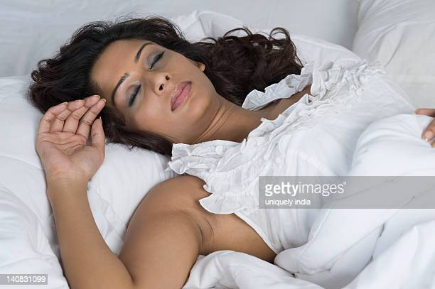 Close-up of a woman sleeping on the bed