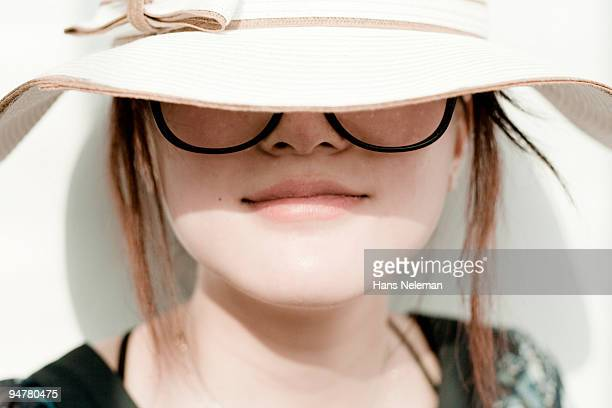 Close-up of a woman wearing a sun hat