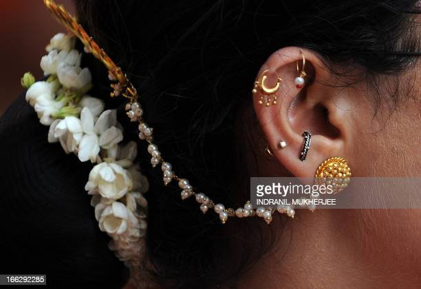 Close-up of a woman wearing traditional jewellery is seen during a procession celebrating 'Gudi Padwa' or the Maharashtrian new year in Mumbai on...
