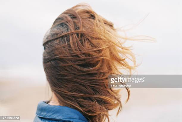 close-up of a woman with windswept hair - windswept stock pictures, royalty-free photos & images