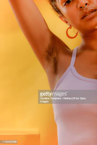 closeup of a woman's armpit - armpit hair stock-fotos und bilder