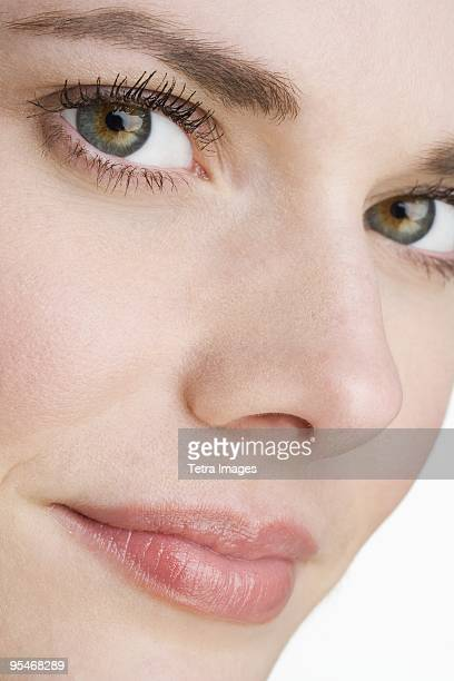close-up of a woman's face - 鼻 ストックフォトと画像