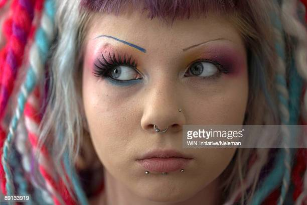 close-up of a woman's face with make-up and facial piercings, kiev, ukraine - piercing stock-fotos und bilder