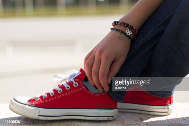 close-up of a woman's feet wearing sneakers - human foot stock pictures, royalty-free photos & images