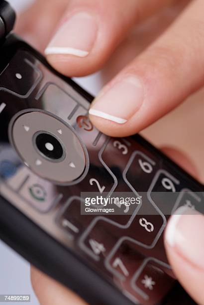 Close-up of a woman's finger using a mobile phone