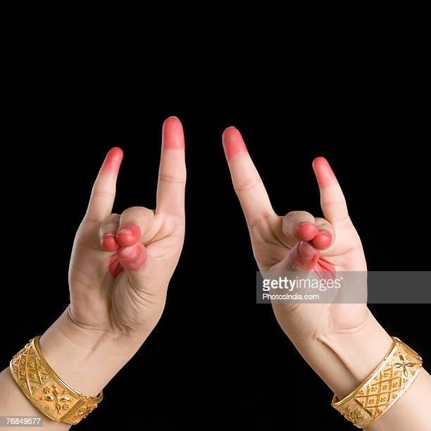 Close-up of a woman's hand making a Bharatnatyam gesture
