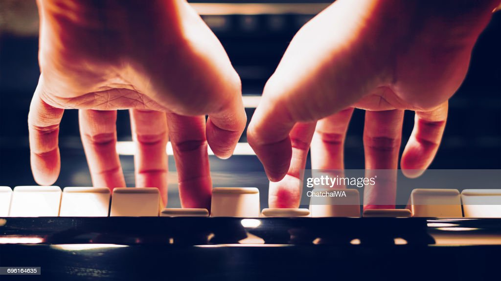 Close-up of a woman's hands playing the piano : Stock Photo