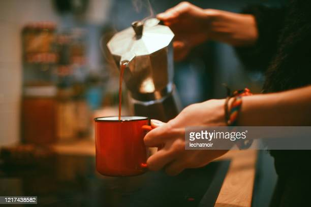 close-up of a woman's hands pouring coffee - making stock pictures, royalty-free photos & images