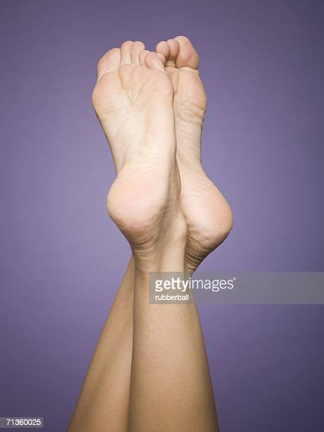 close-up of a woman's legs - woman soles stock photos and pictures