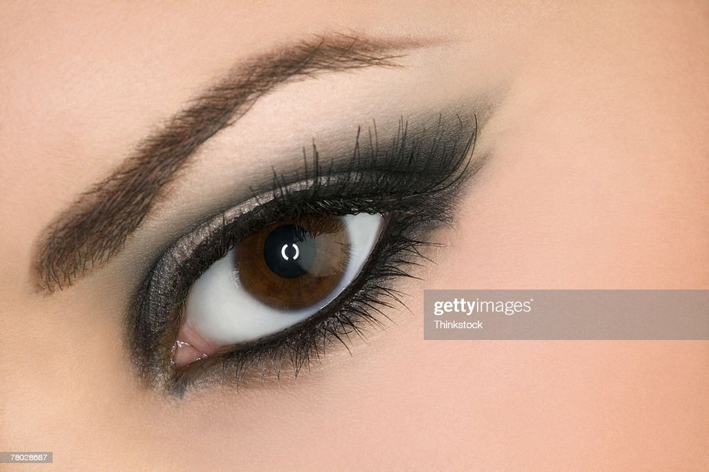 Close-up of a woman's open eye with make-up and mascara looking at the viewer. : Stock Photo