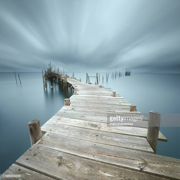 close-up of a wooden jetty, cais palafitico da carrasqueira, comporta, portugal - comporta portugal stock photos and pictures