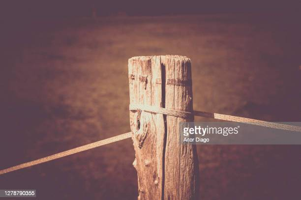 close-up of a wooden post of a fence. retro style - execution stock pictures, royalty-free photos & images