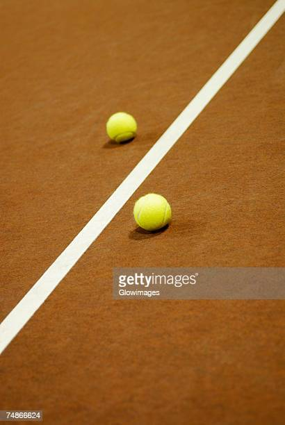 Close-up of a yard line between two tennis balls