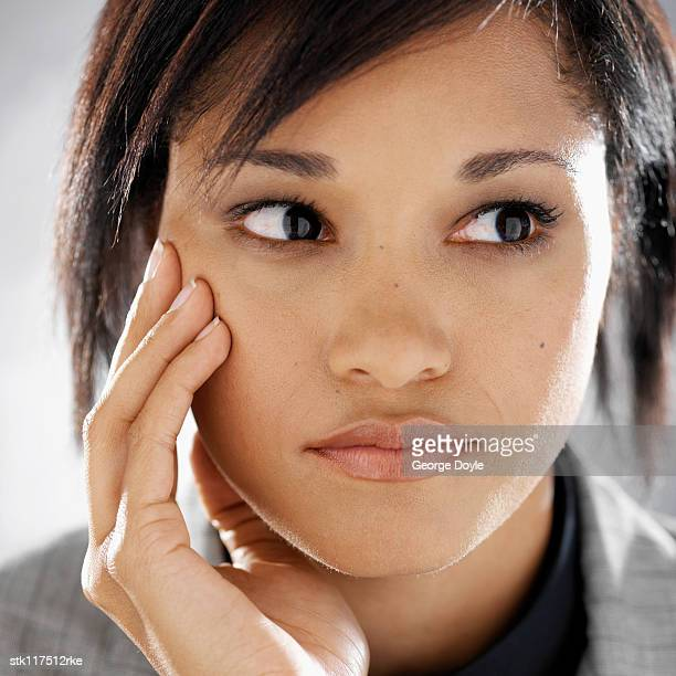 close-up of a young businesswoman's face - cheek stock pictures, royalty-free photos & images