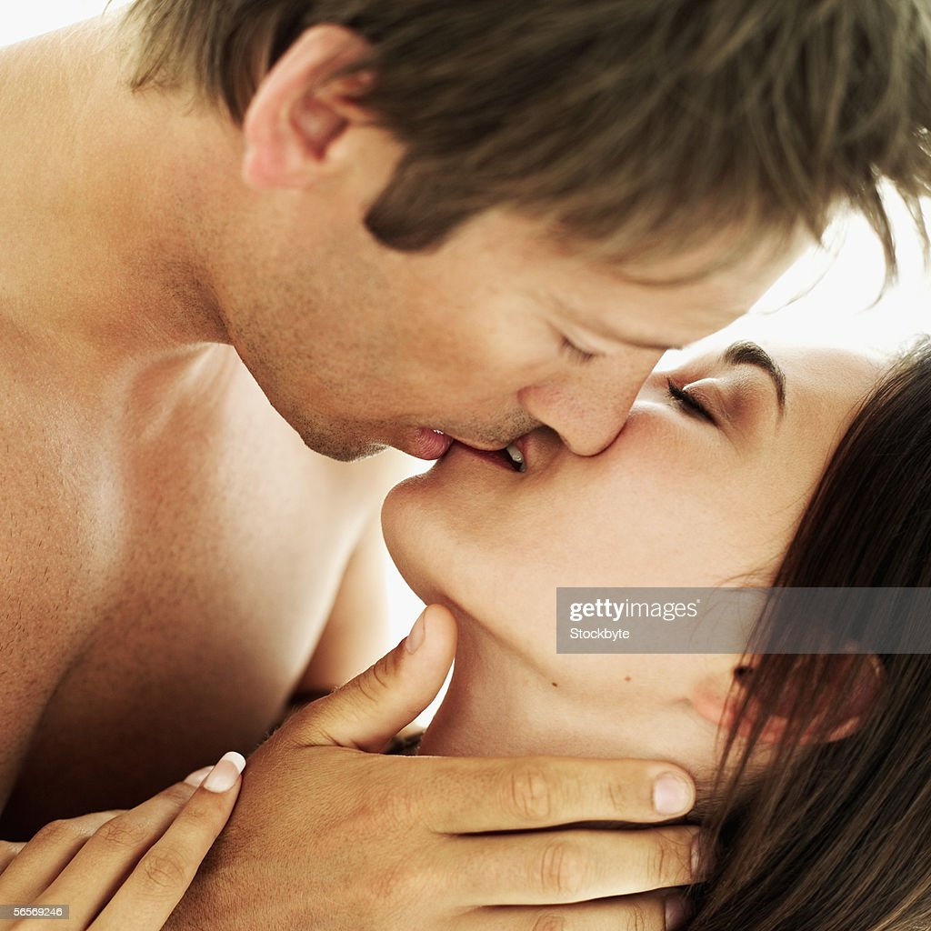 close-up of a young couple kissing : Stock Photo