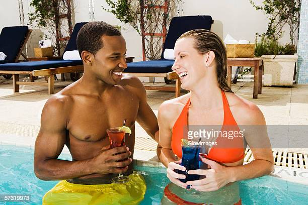 Close-up of a young couple looking at each other in a swimming pool
