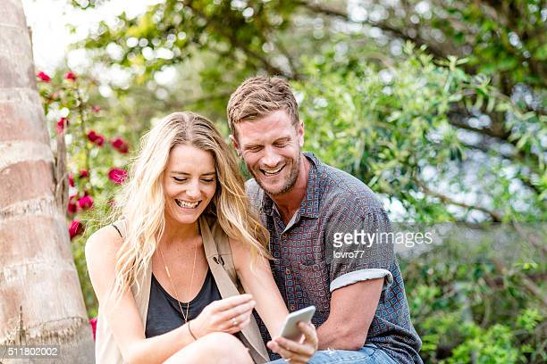 Close-up of a young couple looking at mobile phone