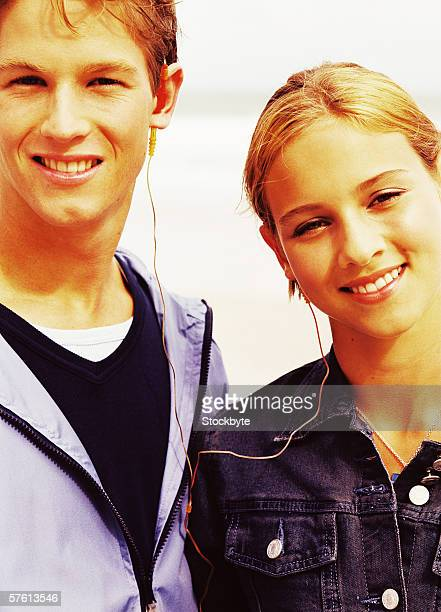 Close-up of a young couple sharing earphones