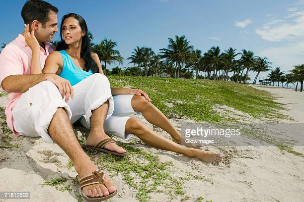 Close-up of a young couple smiling on the beach
