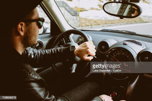 close-up of a young man in car - muscle car stock photos and pictures