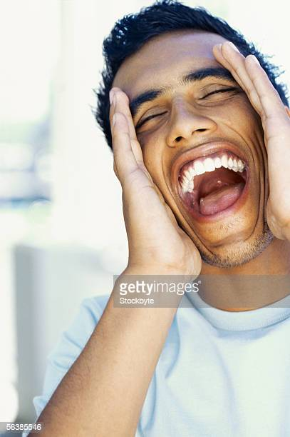 close-up of a young man shouting - uvula stock photos and pictures