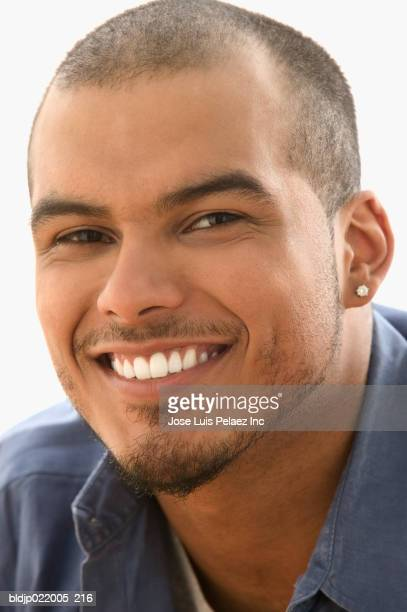 close-up of a young man smiling - puerto rican ethnicity stock pictures, royalty-free photos & images