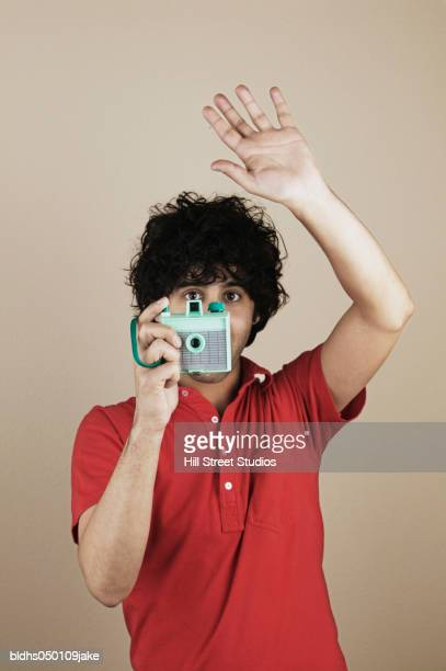 Close-up of a young man taking a photograph