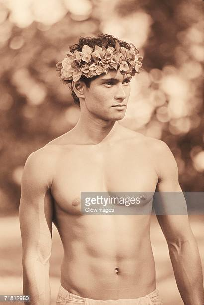 Close-up of a young man wearing a laurel wreath, Hawaii, USA