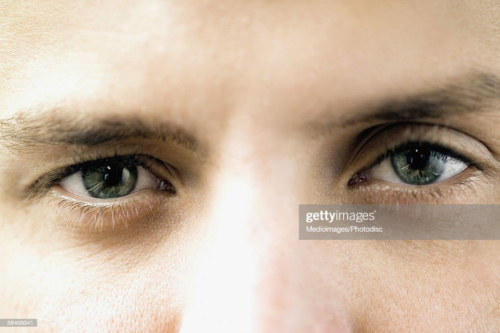 Close-up of a young man's eyes : Stock Photo