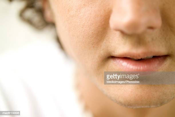 close-up of a young man's nose and mouth - pores stock photos and pictures