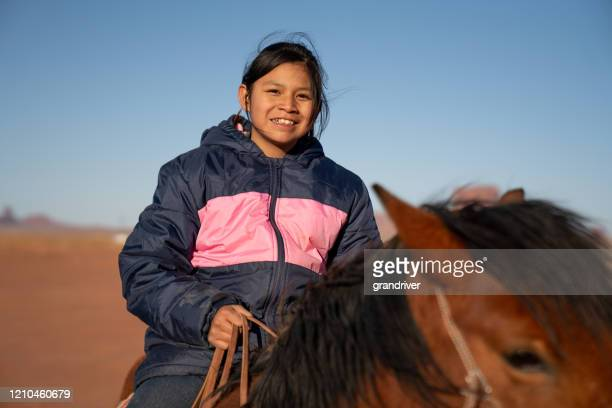 closeup of a young navajo teenager on her horse - native american reservation stock pictures, royalty-free photos & images