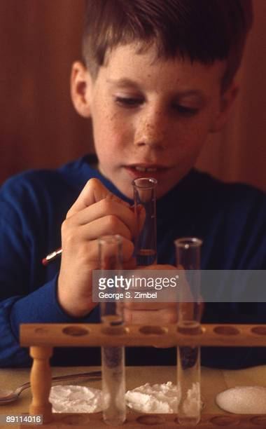 Closeup of a young student as he marks a vial in for an experiment Peekskill New York late 1960s