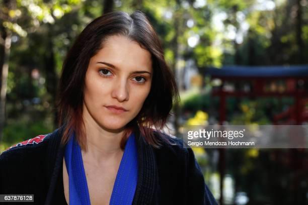 A closeup of a young woman - a blue belt in Brazilian Jiu-Jitsu